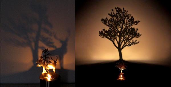 壁に木や動物の影が映ります